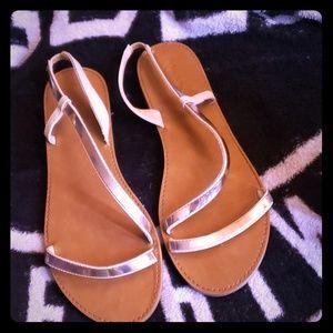 Rose gold sandals.
